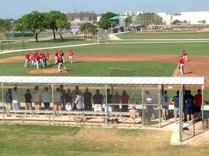 MLB pitchers go through drills while fans watch close by